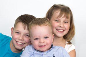 Happy young children studio portrait