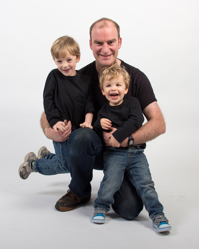 Father with young sons studio portrait