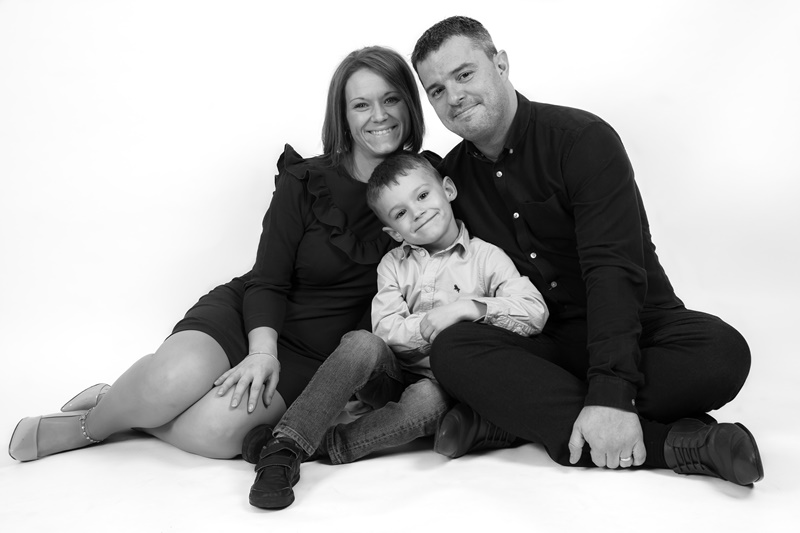 Mom dad and son contemporary family studio portrait