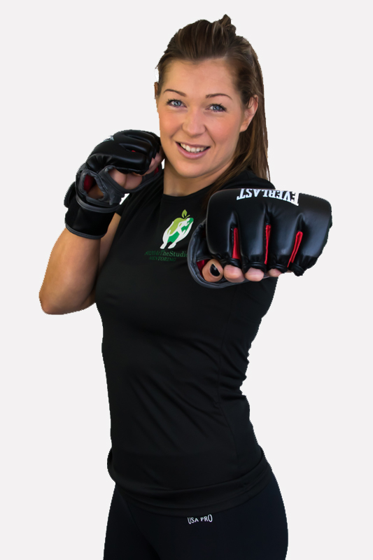 Pretty female boxer and fitness instructor studio portrait