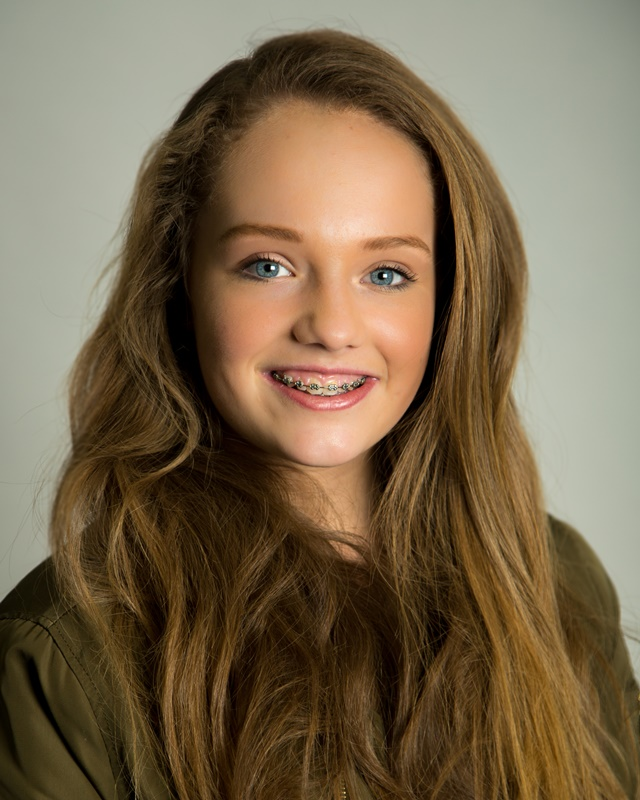 Pretty teen girl smiling studio portrait
