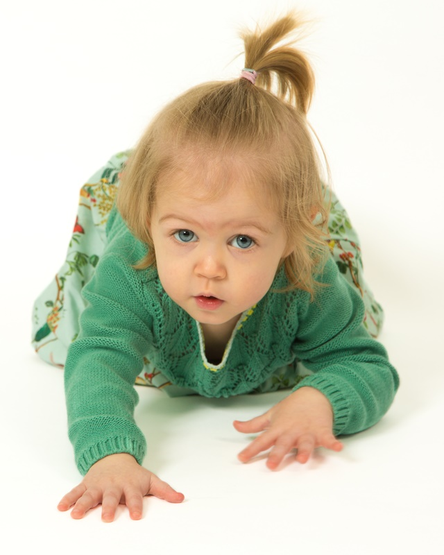 Cute toddler girl crawling